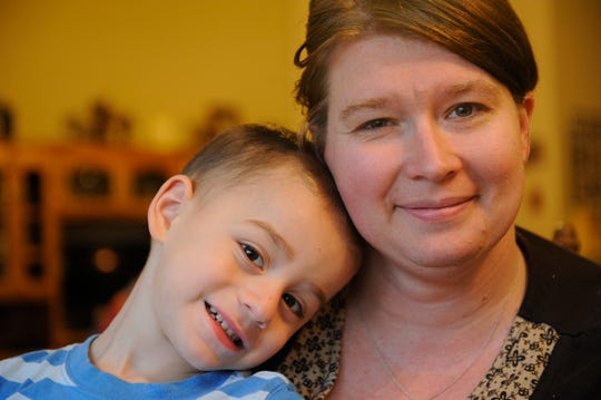"""Oliver Ajluni, 3, smiles with his mother, Shannan Ajluni, 36, in their Visalia home. He has battled Langerhan Cell Histiocytosis, a rare cancer/autoimmune hybrid disease for two years. He is currently in remission, however he suffers a hearing loss and seizures. Thanks to his family, he's adopted a """"name your problems, it makes it easier to fight them"""" attitude."""