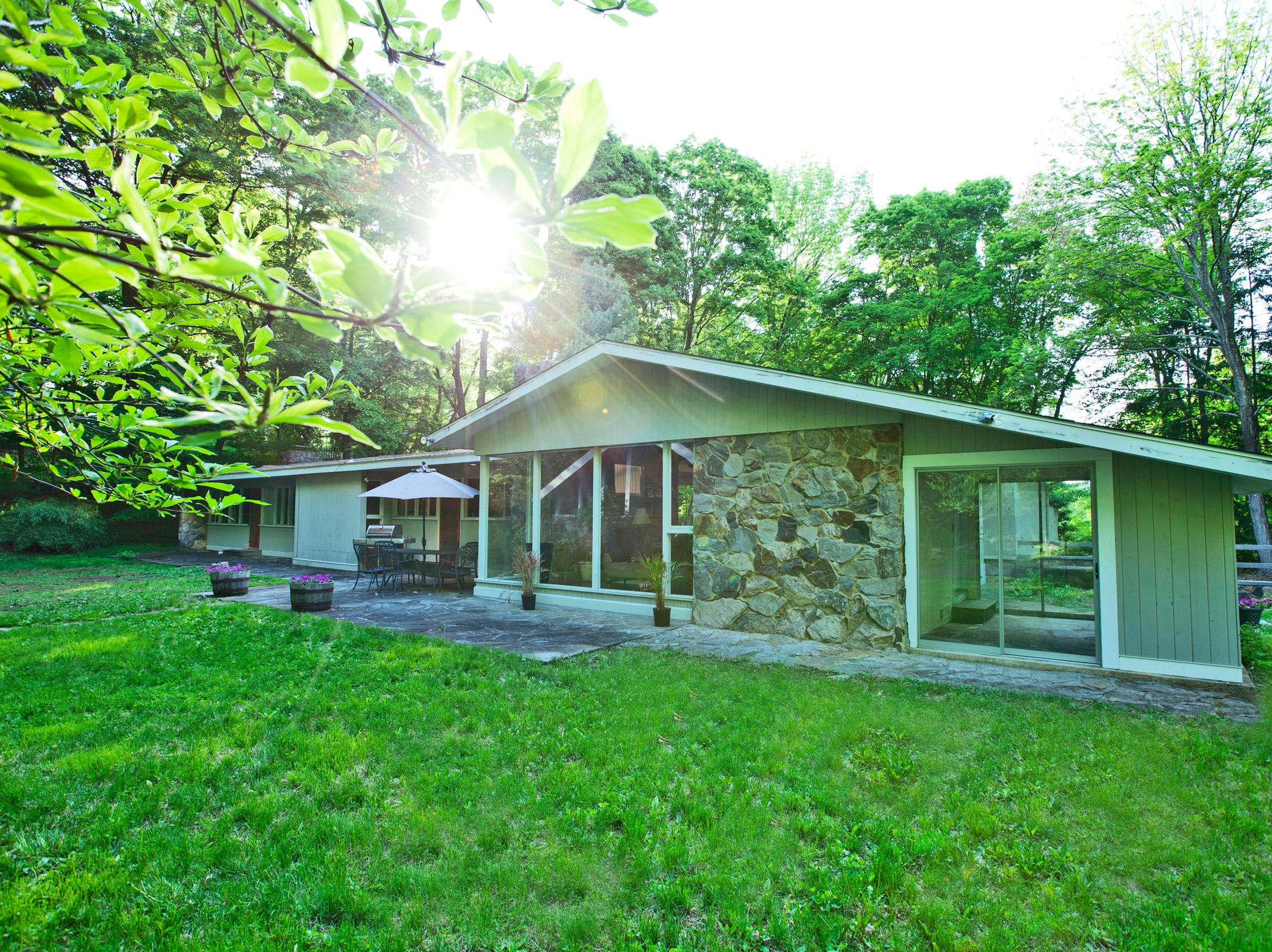 The separate cottage at a Midcentury modern home for sale in Pound Ridge