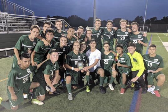 Oscar Gonzalez (24) poses with his Brewster teammates following a season-opening win over Dover in the Putnam v. Dutchess Challenge.