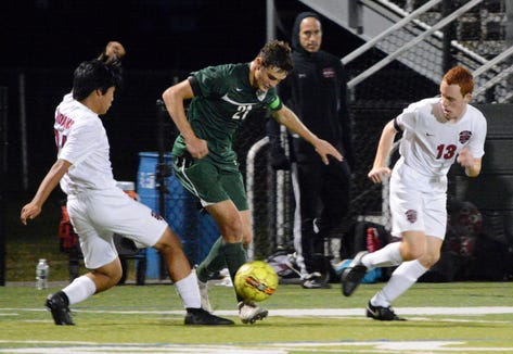 Brewster sweeper Anthony Ferrandino ends a Nyack possession during a 2-0 win on Sept. 24, 2018.