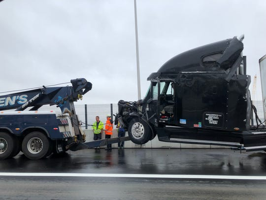 A jackknifed tractor-trailer is towed away on the eastbound lane of the Gov. Mario M. Cuomo Bridge on Thursday, October 11, 2018.