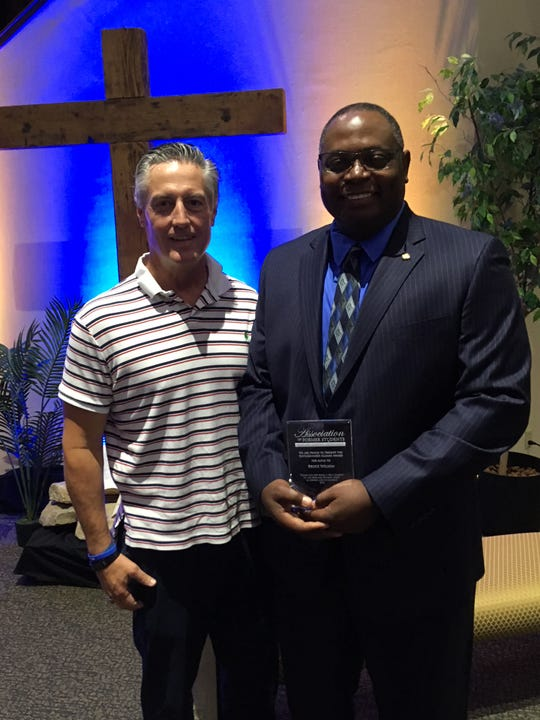 Bruce Wilson, right, advisor at Western Oklahoma State College, received the alumni award for Altus Campus at the Sept. 28 ceremony. He is pictured afterward with Dr. Jerry Faught, executive director of the Altus Campus.