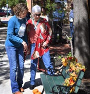Becky Morath, left, and June Seigler look over the new bench dedicated in memory of Ernest Seigler, June's late husband. Ernest Seigler was a Clay County farmer and supporter of the area's Farmers Markets.