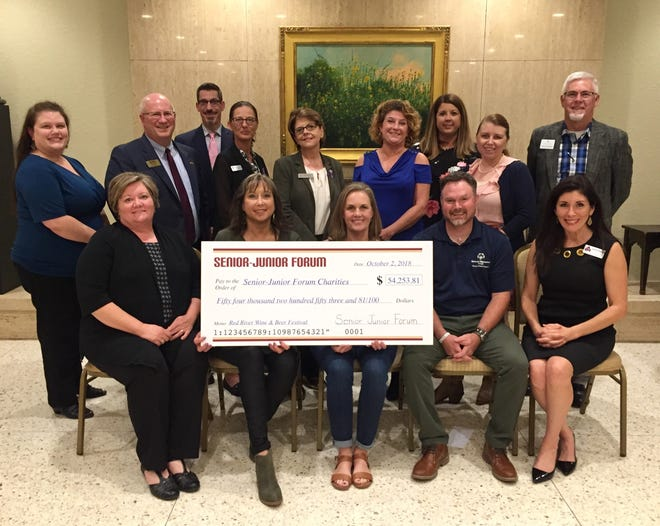 The Senior Junior Forum distributes more than $54,000 earned at the 2018 Red River Wine & Beer Festival to nonprofit groups and charities in the community. The festival is the largest SJF fundraiser. Participating in the presentation were (Back row, from left to right) Laura Hetrick, MSU Counseling and First Step Board Member; Dr. Tony Vidmar, MSU University Advancement and Public Affairs;  Dirk Welch, MSU-Burns Fantasy of Lights; Michelle Turnbow, First Step Shelter Manager; Debra Dyson, First Step Executive Director; Deanna Dockman-Henry, Beacon Lighthouse for the Blind Executive Assistant and Human Resources; Susan Phillips, 2017-18 SJF Community Service Chair; Charlotte Dameron, Backdoor Theatre kids Program; Steve Sparks, Faith Mission CEO; (Front row, seated left to right) Mary Brasher, SJF Past President; Liz Wathen, 2018 Co-Chair of the RRW&BF; Lesa Reimers, 2018 Co-Chair of the RRW&BF; Mike Strickland, Special Olympics Executive Director for the North Texas Region; Pamela Hughes, The Kitchen/Meals on Wheels Director of Marketing and Development.