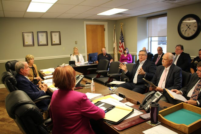 Law enforcement officials, judges and prosecutors met with Muskingum County commissioners to protest the Issue 1 proposed Ohio amendment.
