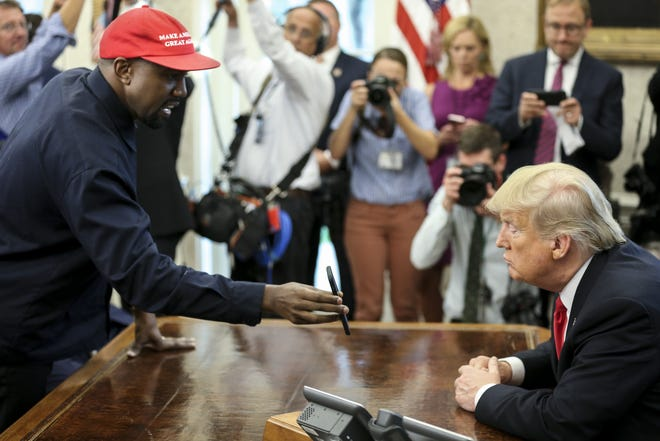 Kanye West shows President Trump a photo of a powered plane he says he's developing with Apple.
