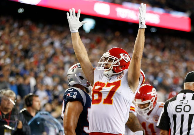 Kansas City Chiefs tight end Travis Kelce (87) celebrates a fourth quarter touchdown by running back Kareem Hunt (27) (not pictured) at Gillette Stadium.