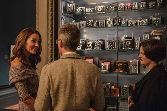 """Duchess Kate views the """"Collecting Photography: From Daguerreotype to Digital"""" exhibit as she opens the new photography center at the Victoria and Albert Museum in London on Oct. 10, 2018."""