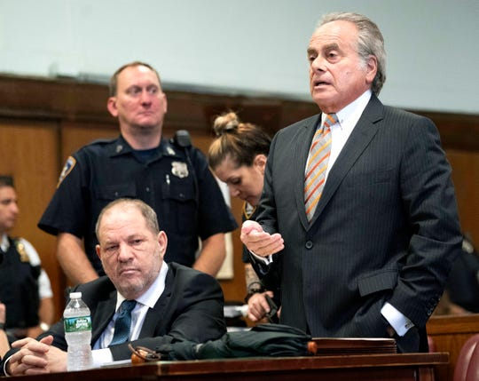 Harvey Weinstein, left, as his attorney Benjamin Brafman speaks at a hearing in New York, Oct. 11, 2018, during which part of the sex-crimes case against Weinstein was dropped.
