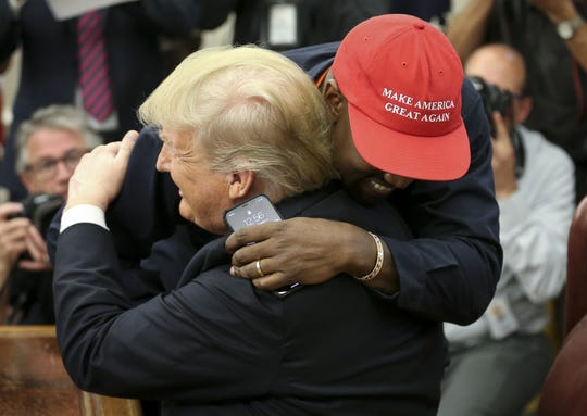 Kanye West hugs President Donald Trump after arriving in the Oval Office during his White House visit on Thursday.