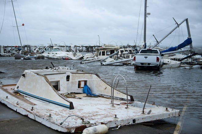 Damaged boats and a truck are seen in a marina after Hurricane Michael October 10 in Panama City, Florida.