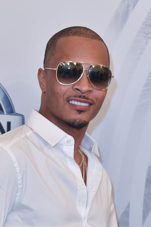 Rapper T.I. says he's had it with Kanye West.