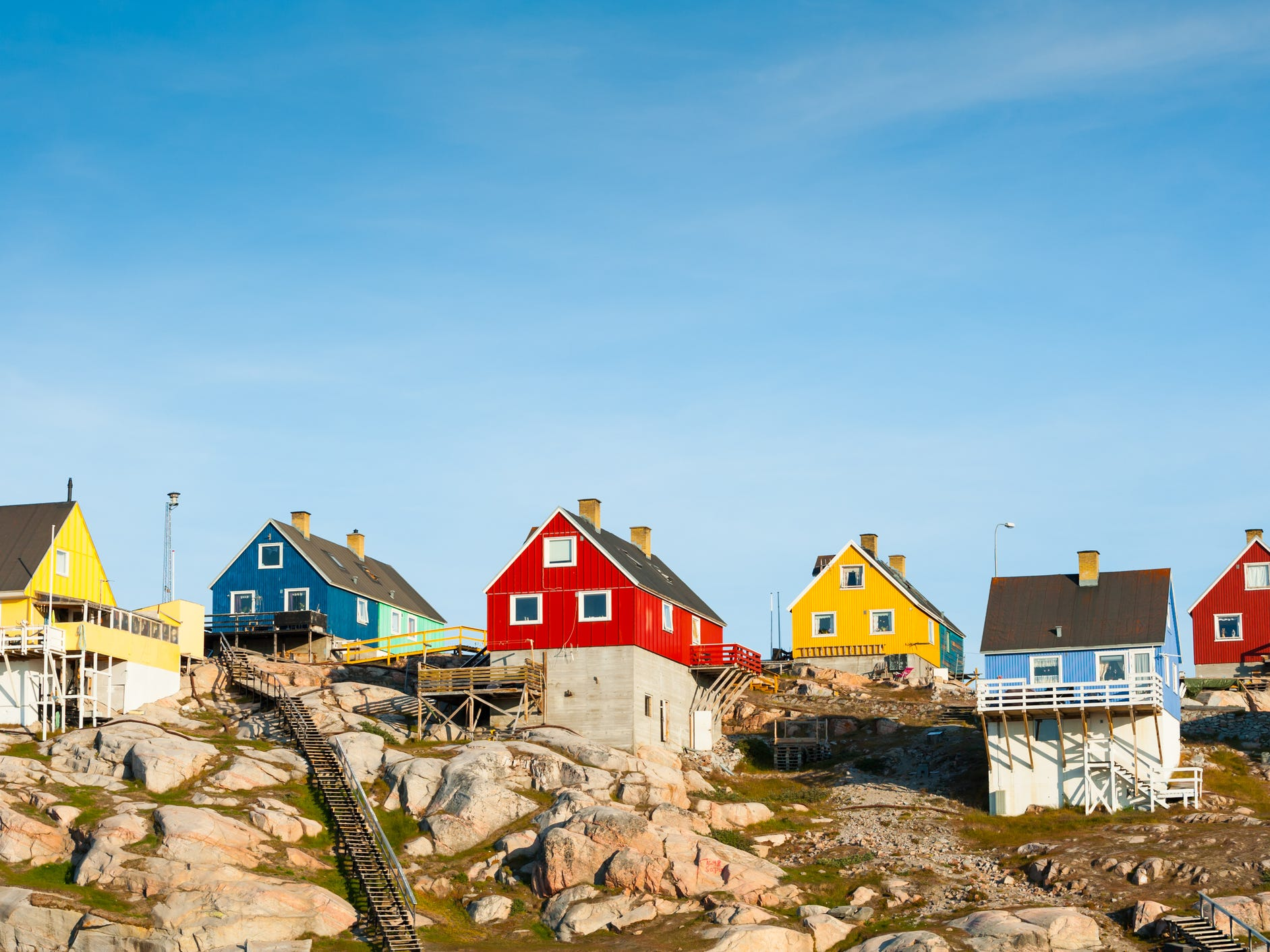 According to Greenlandic tradition, the color of a building indicates its purpose: yellow for hospitals, blue for fish factories, red for commercial properties, and so on. These days, however, you'll see a wider, more whimsical range of colors in Greenlandic towns like Ilulissat.