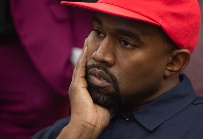 Kanye West listens to President Trump.