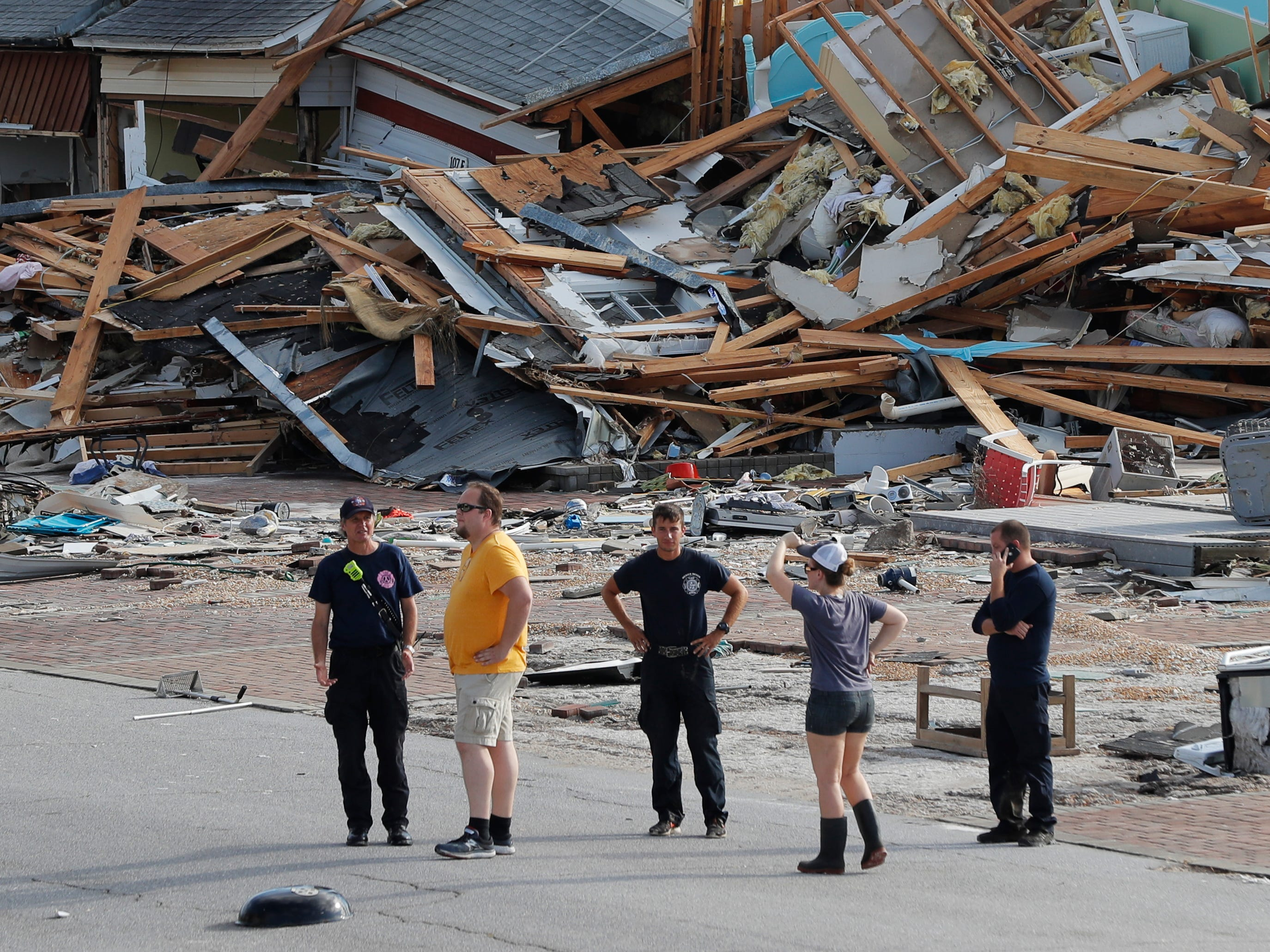 Rescue personnel perform a search in the aftermath of Hurricane Michael in Mexico Beach, Fla., Thursday, Oct. 11, 2018.