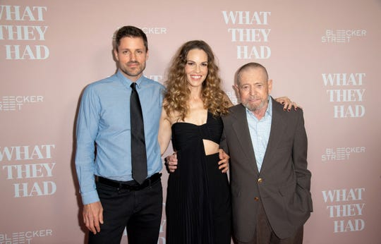 "A sweet family moment: Hilary Swank brought her new husband, Philip Schneider (left), and father Stephen Michael Swank to the Oct. 9 premiere of ""What They Had"" in Los Angeles."