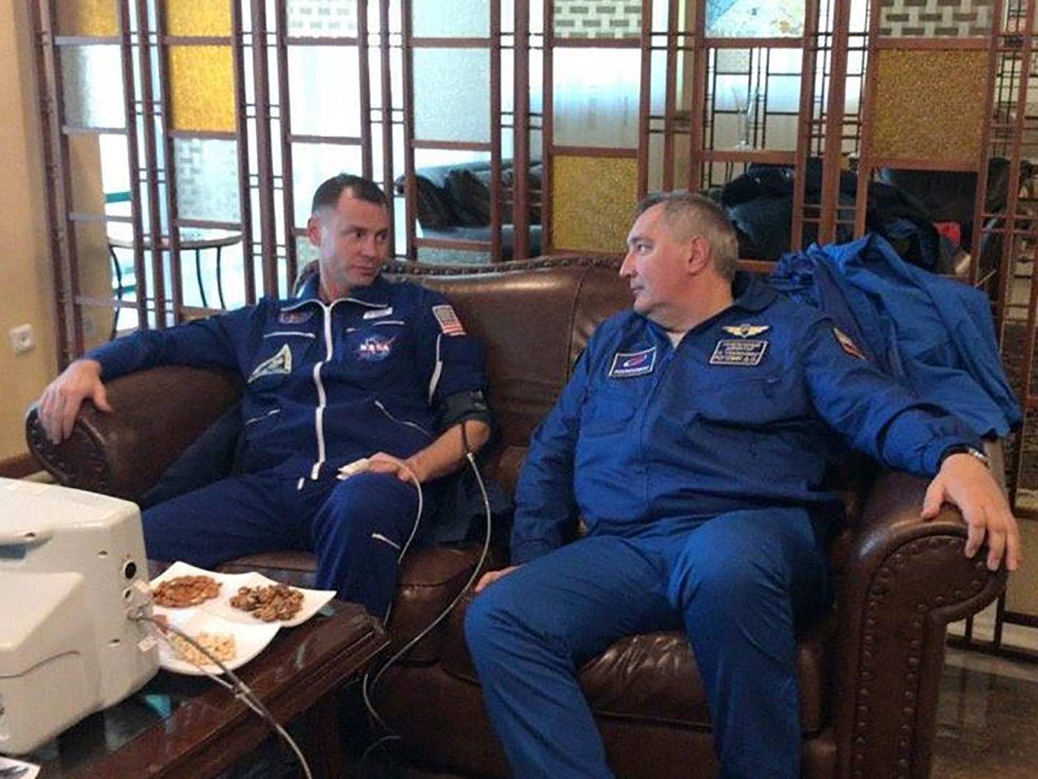 "In this handout picture released on Russia's space agency Roscosmos Twitter account on October 11, 2018, NASA astronaut Nick Hague undergoes medical examination in the town of Dzhezkazgan (Zhezkazgan), Kazakhstan. - The two-man crew of a Soyuz rocket made a successful emergency landing Thursday after an engine problem on lift-off to the International Space Station, in a major setback for the beleaguered Russian space industry. Hague and Russian Ovchinin were rescued without injuries in Kazakhstan. (Photo by HO / Russian Space Agency Roscosmos / AFP) / RESTRICTED TO EDITORIAL USE - MANDATORY CREDIT ""AFP PHOTO / Russia's space agency Roscosmos Twitter account / HO"" - NO MARKETING NO ADVERTISING CAMPAIGNS - DISTRIBUTED AS A SERVICE TO CLIENTSHO/AFP/Getty Images ORIG FILE ID: AFP_19Y0LK"