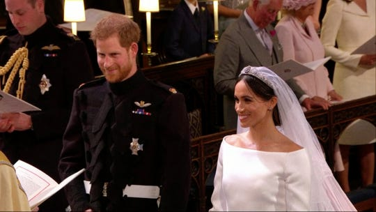 Prince Harry and Meghan Markle at their wedding in St. George's Chapel at Windsor Castle, May 19, 2018.