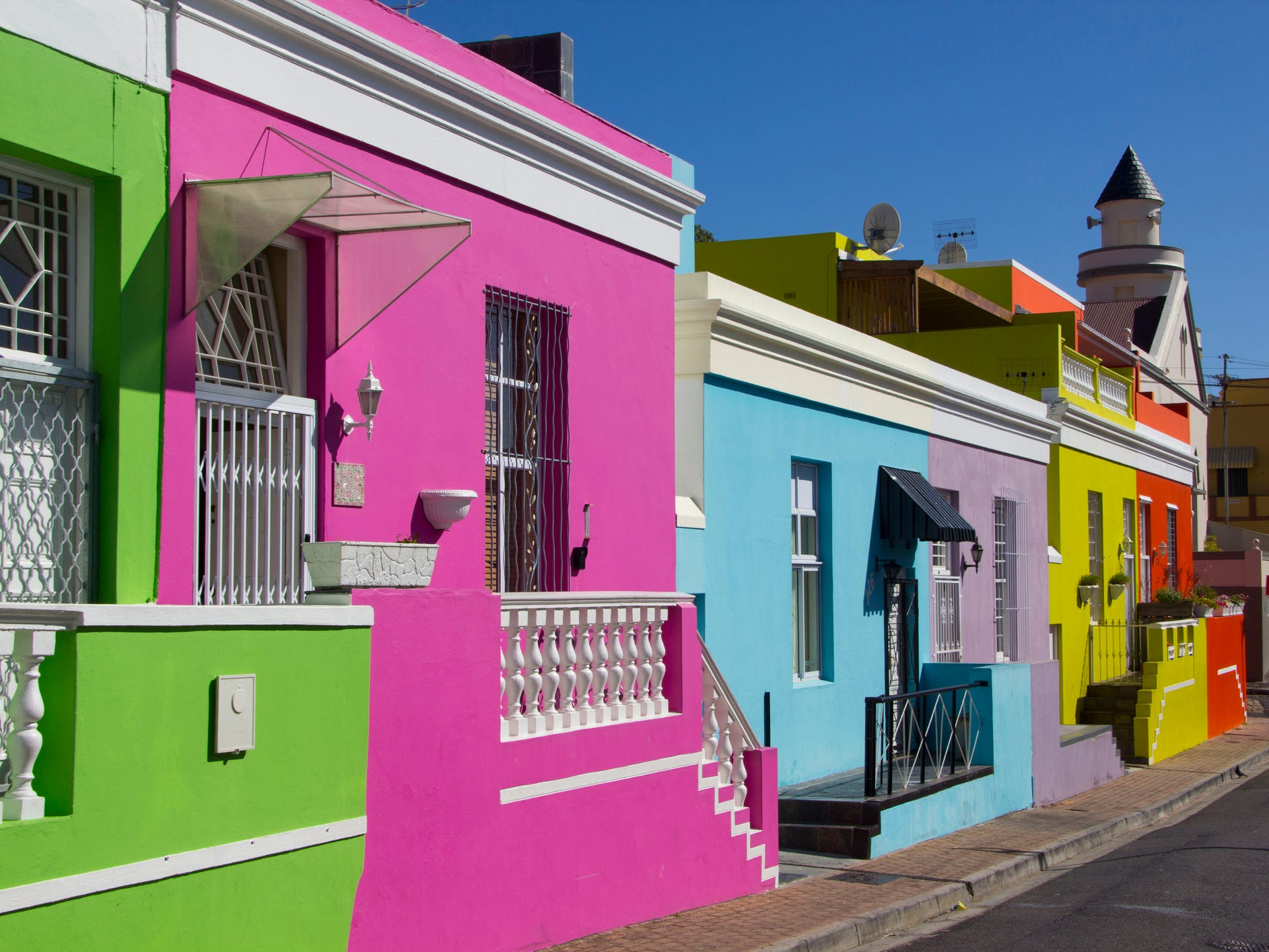 Cape Town, South Africa: Cape Town's rainbow-colored Bo-Kaap neighborhood wasn't always such a kaleidoscope of color. The buildings here were originally used as rental homes for slaves, who weren't allowed to change the white exteriors of the houses.
