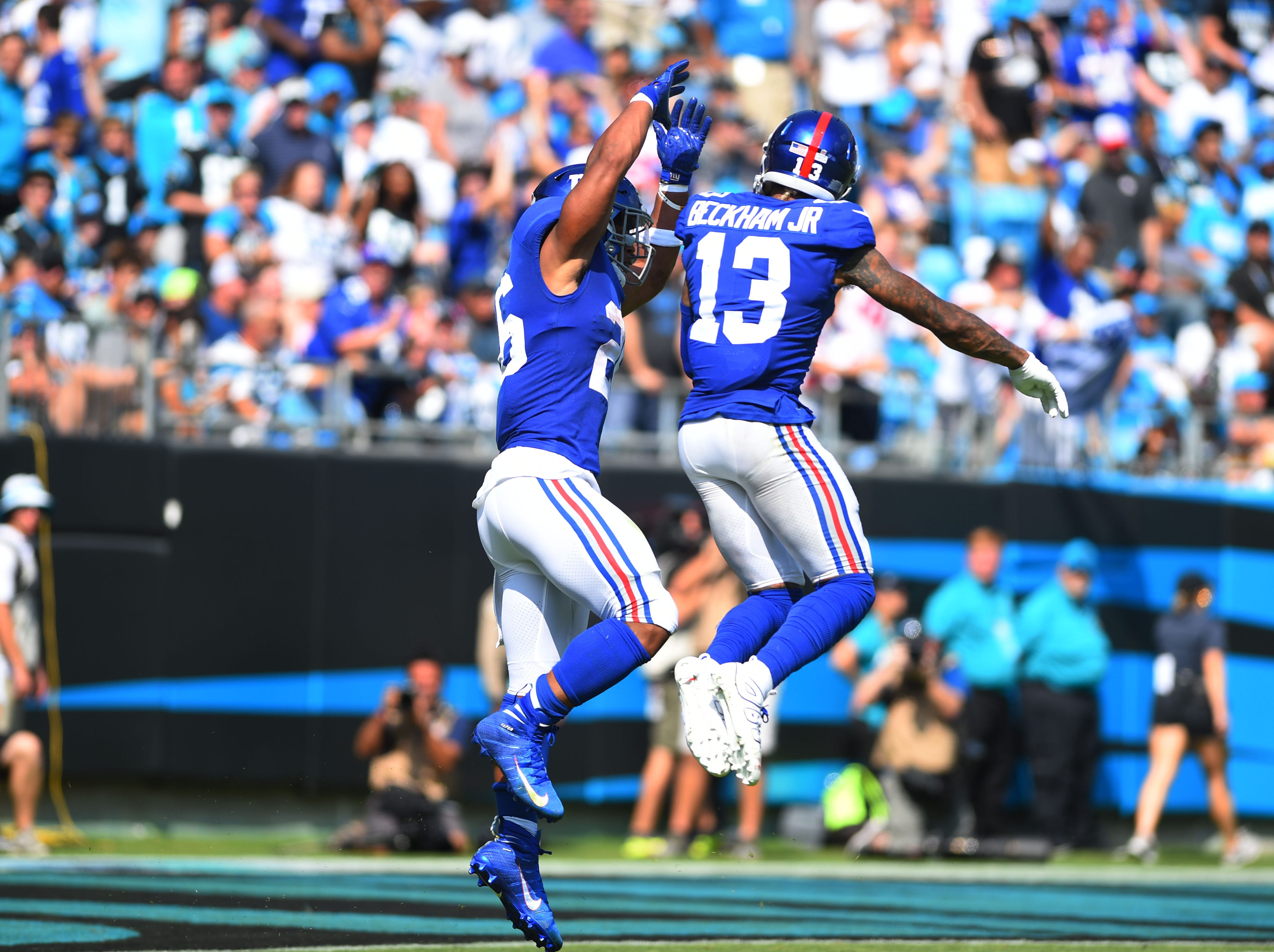 Giants running back Saquon Barkley, left, and wide receiver Odell Beckham Jr. combined for the wackiest touchdown in Week 5 -- a 57-yard TD pass from Beckham to Barkley.