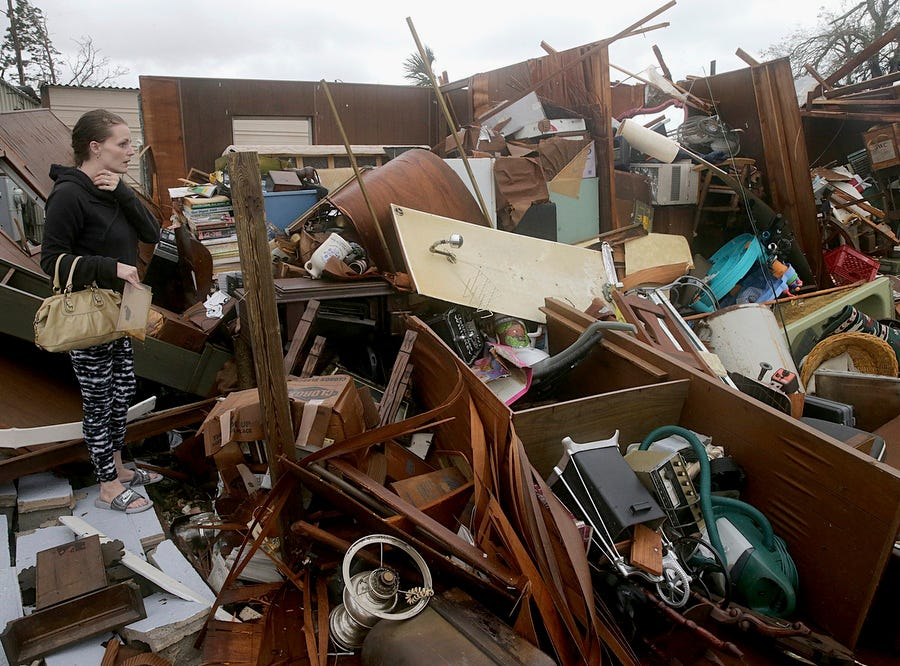 Haley Nelson inspects damages to her family properties in the Panama City, Fla., spring field area after Hurricane Michael made landfall in Florida's Panhandle on Wednesday, Oct. 10, 2018. Supercharged by abnormally warm waters in the Gulf of Mexico, Hurricane Michael slammed into the Florida Panhandle with terrifying winds of 155 mph Wednesday, splintering homes and submerging neighborhoods before continuing its march inland. (Pedro Portal/Miami Herald via AP) ORG XMIT: FLMIH301