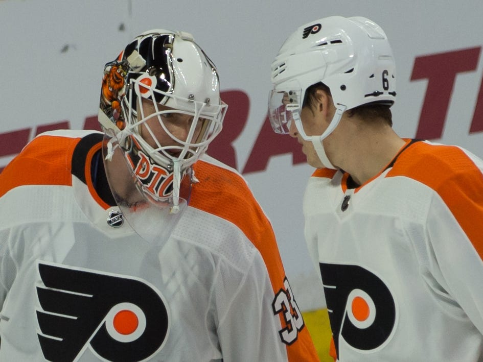 Oct. 10: Philadelphia Flyers goalie Calvin Pickard, wearing his new Gritty mask, is congratulated by Travis Sanheim after a 7-4 win against the Ottawa Senators.