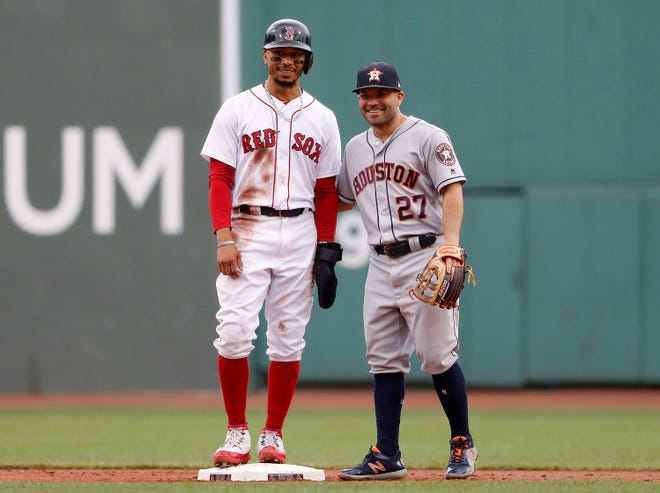 Mookie Betts and Jose Altuve during a game at Fenway Park in September.