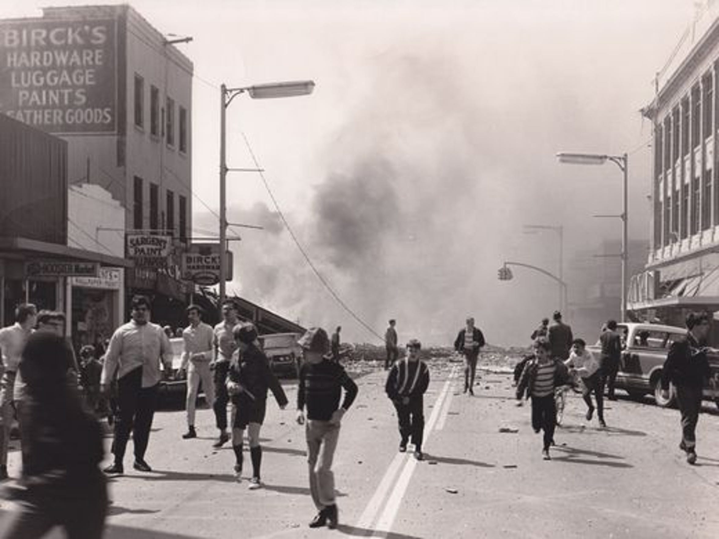 "Youth who had been watching Elvis Presley's ""Stay Away, Joe"" at the State Theatre flee the scene if a natural gas fire in downtown Richmond, Ind. on April 6, 1968, which killed 41 people."
