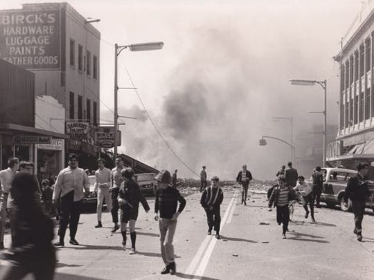 """Youth who had been watching Elvis Presley's """"Stay Away, Joe"""" at the State Theatre flee the scene if a natural gas fire in downtown Richmond, Ind. on April 6, 1968, which killed 41 people."""