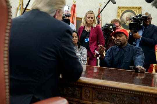 Rapper Kanye West speaks during a meeting in the Oval Office of the White House with President Donald Trump. They talked about one of the president's favorite talking points to promote the success of his administration: the record unemployment rate among blacks.