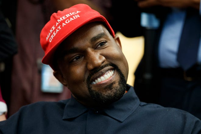 "Rapper Kanye West smiles as he listens to a question from a reporter during a meeting in the Oval Office.  West has taken a lot of heat for his support of Donald Trump and wearing his ""Make America Great Again"" cap."