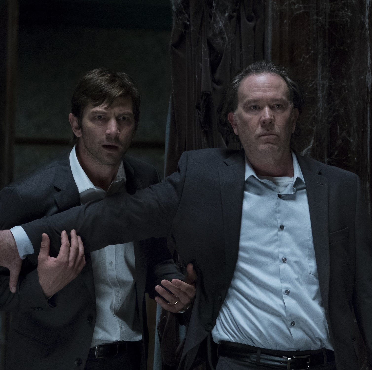 """Netflix's """"The Haunting of Hill House,"""" based on a 1959 novel of the same name, follows a family who once lived in an old mansion that may be haunted. The series' stars include Michiel Huisman and Timothy Hutton."""