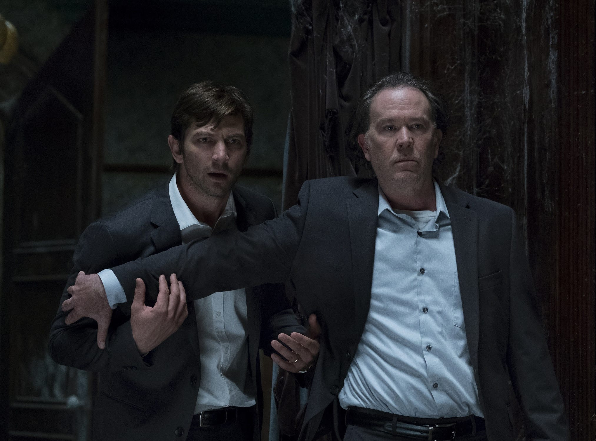 "Netflix's ""The Haunting of Hill House,"" based on a 1959 novel of the same name, follows a family who once lived in an old mansion that may be haunted. The series' stars include Michiel Huisman and Timothy Hutton."