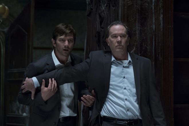 "Netflix's ""The Haunting of Hill House,"" based on a 1959 Shirley Jackson novel of the same name, follows a family who once lived in an old haunted mansion. The series stars include Michiel Huisman, left, and Timothy Hutton."