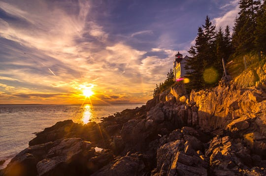 Acadia National Park's beautiful Bass Harbor Light near sunset during the Golden Hour.