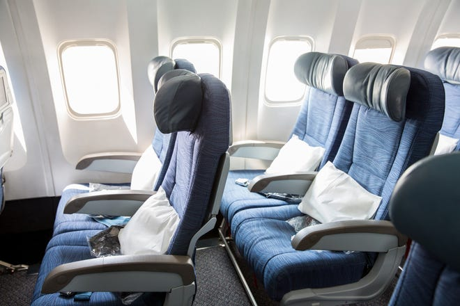Americans are getting larger and airline seats are shrinking.