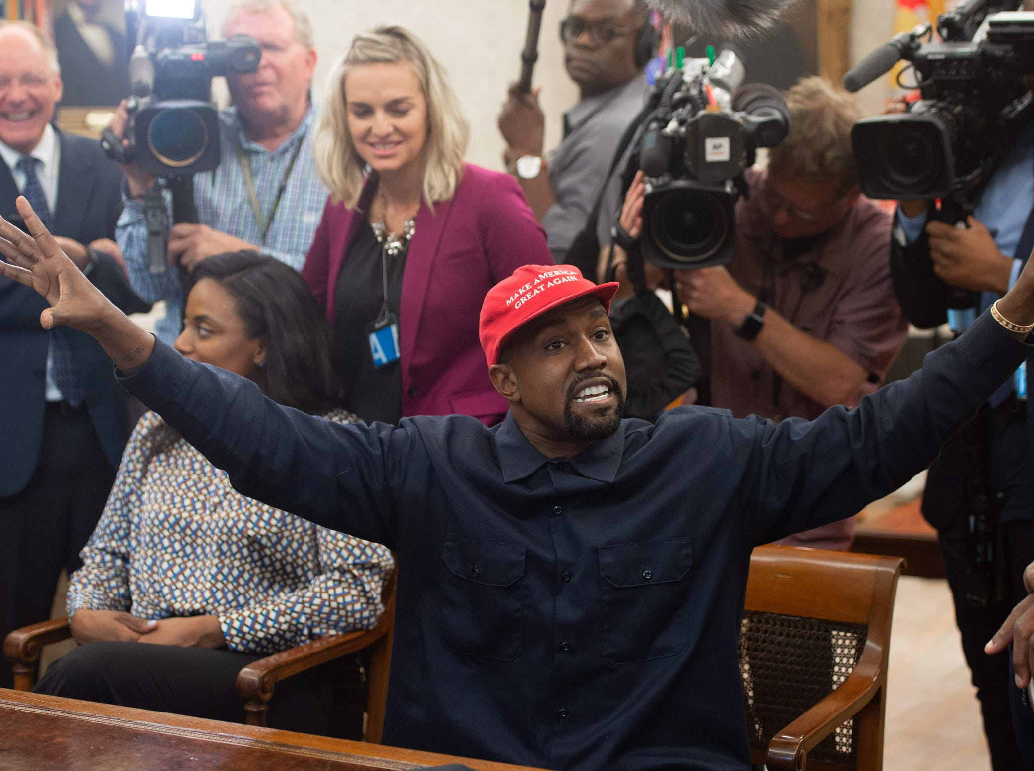 Kanye meets with Trump and plays to the press.
