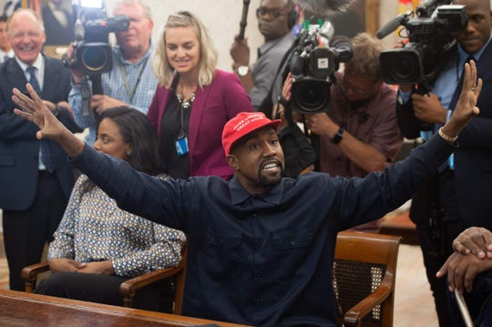 Kanye meets Trump and plays for the press.