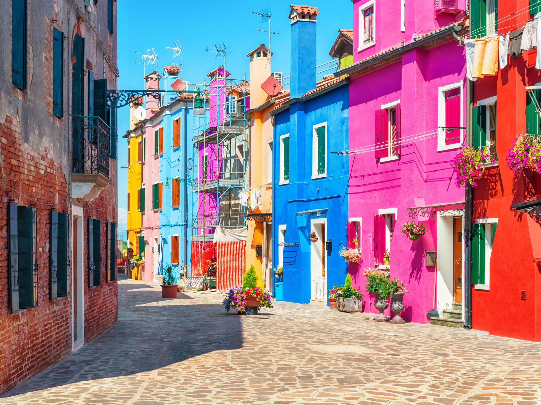 Smaller, quieter and infinitely more colorful, the fishing village of Burano is known for its traditional lace-making industry and for its buildings painted in every shade of the rainbow.