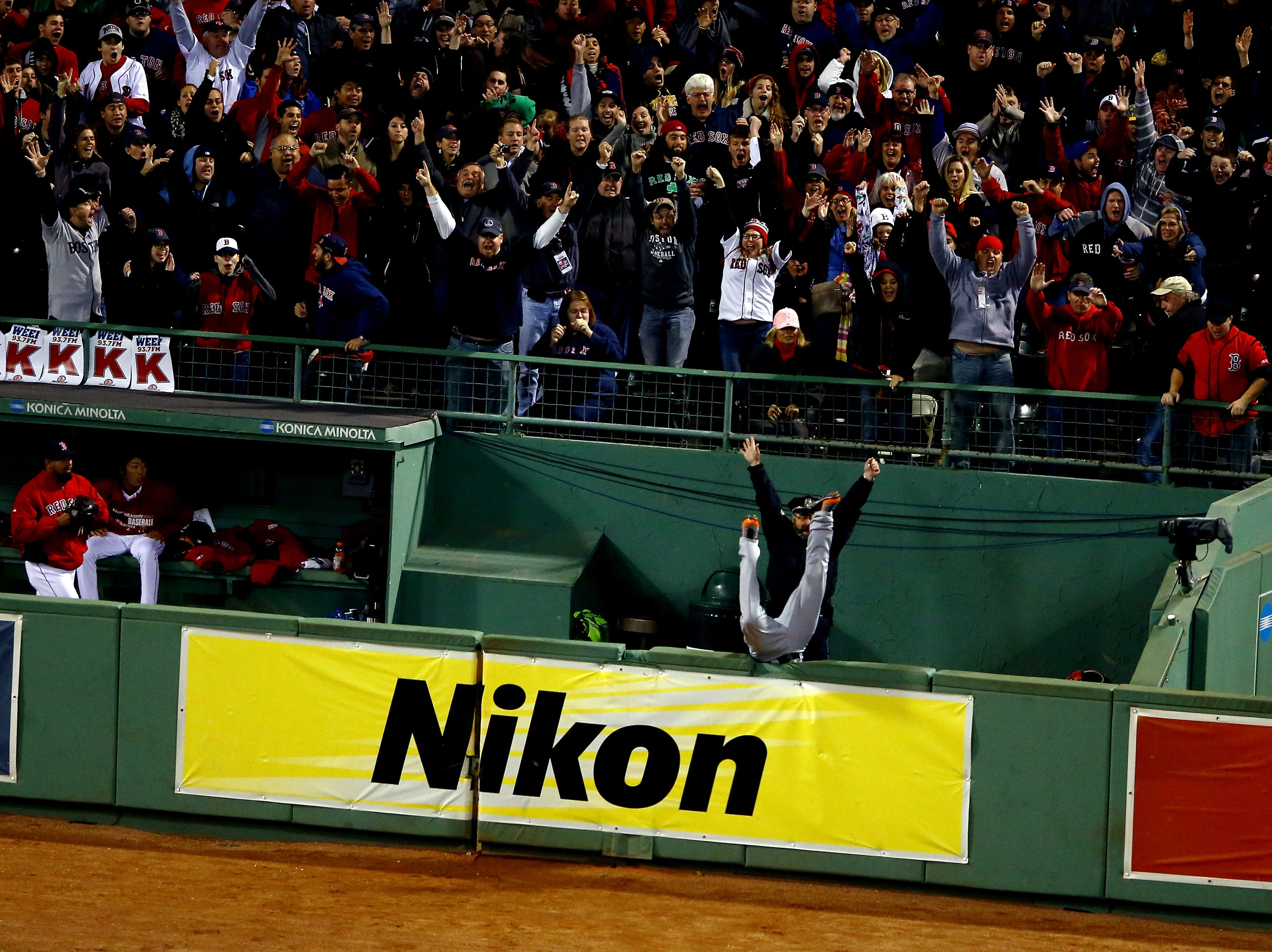 2013 ALCS Game 3: Red Sox designated hitter David Ortiz hit a game-tying grand slam in the eighth inning against the Tigers, sending Torii Hunter into the bullpen trying to make the catch.