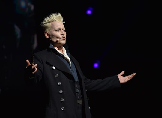 Johnny Depp showed up in character as Grindelwald during a Warner Bros. panel at Comic Con in San Diego this summer.