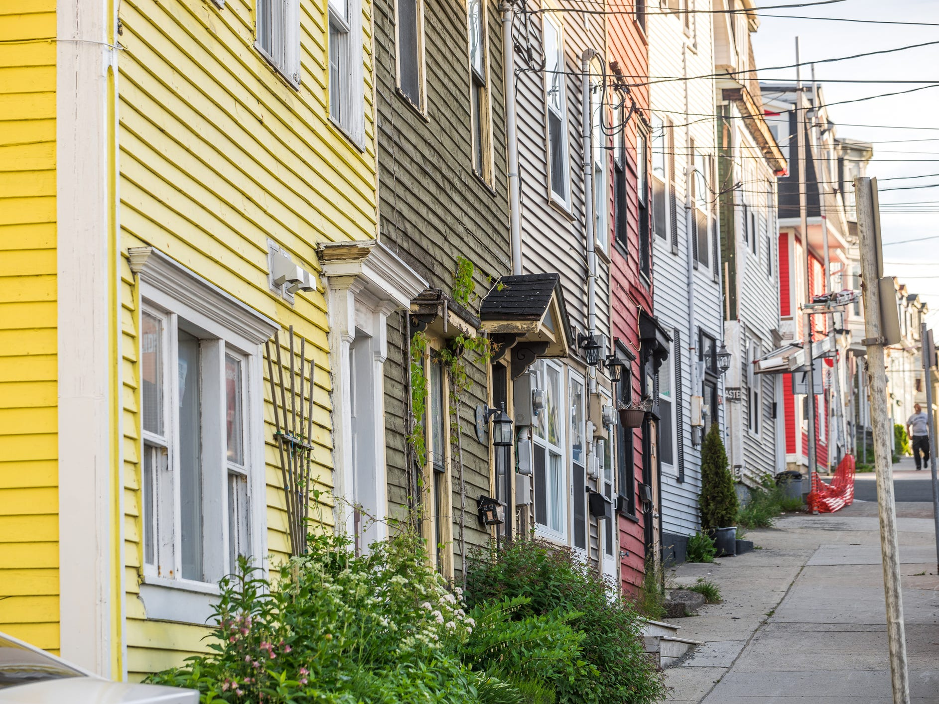 St. John's, Canada: Maroon and sunshine yellow, lavender and lime green, navy blue and burnt orange — you'll find townhouses in just about every hue as you walk around in downtown St. John's, Newfoundland.