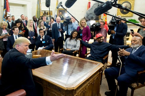 President Donald Trump meets rapper and producer Kanye West and retired football player Jim Brown in the Oval Office on Oct. 11. West, who is a Trump supporter, met with the President to discuss prison reform and other issues.