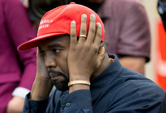 Kanye West gesticulates while speaking in the Oval Office on Thursday. West, who is a Trump supporter, met with the President to talk about prison reform and other issues.
