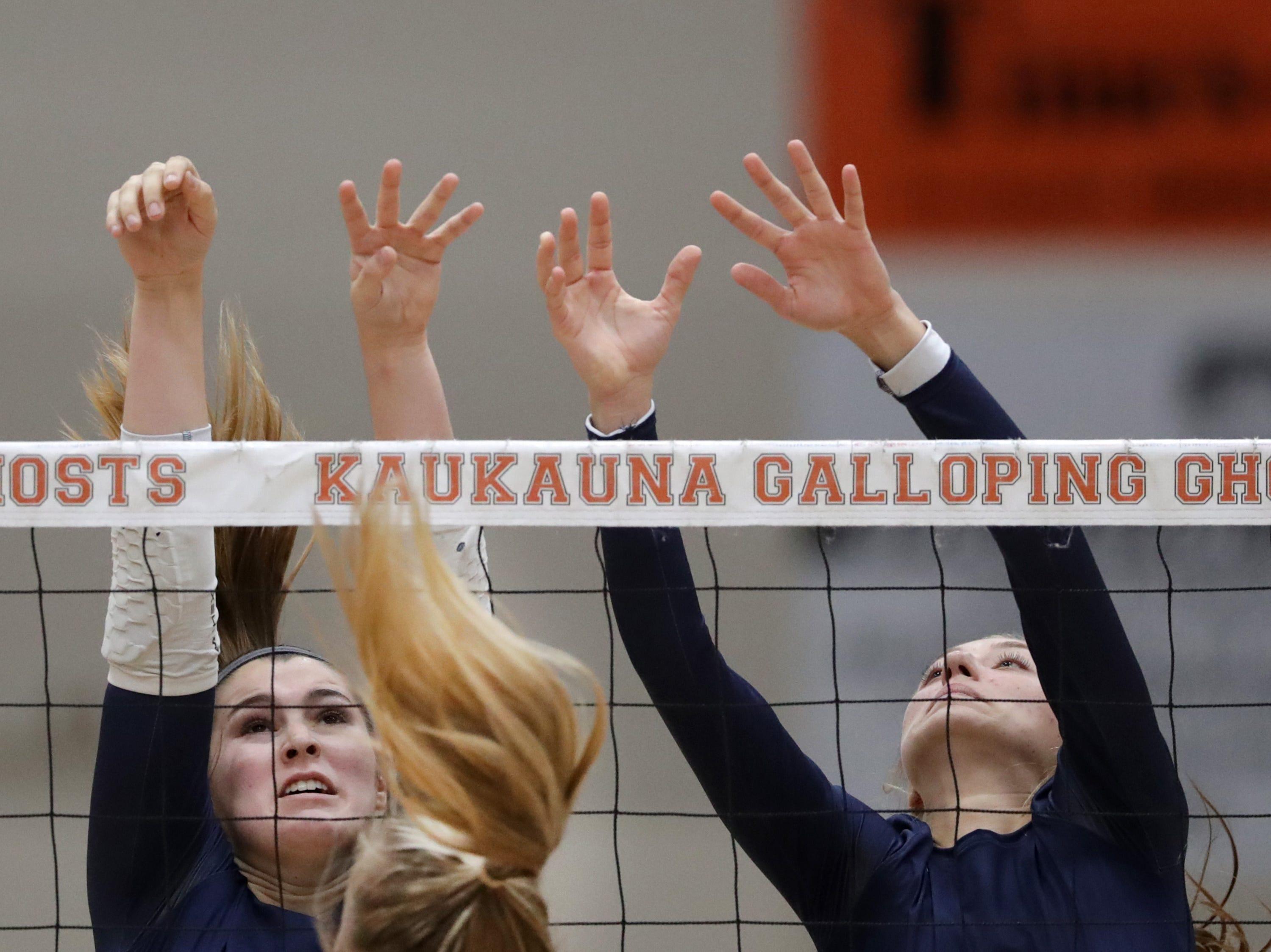 Appleton East High School's #8 Tiffany Paalman and #4 Cameron Neubauer against Kaukauna High School during their girls volleyball game on Thursday, October 11, 2018, in Kaukauna, Wis. Wm. Glasheen/USA TODAY NETWORK-Wisconsin.