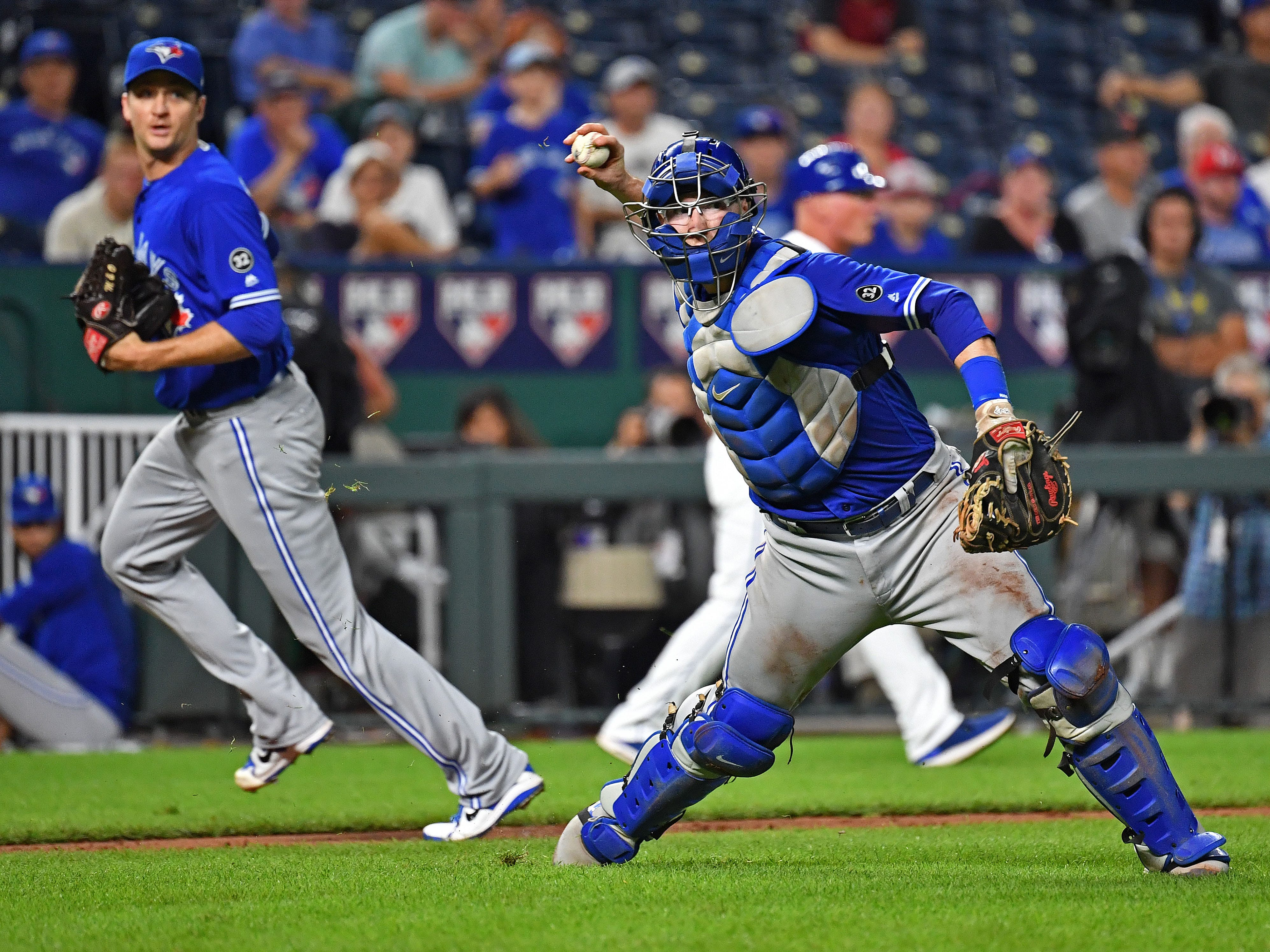 Aug 16, 2018; Kansas City, MO, USA; Toronto Blue Jays catcher Danny Jansen (9) turns to make a throw to first for an out during the sixth inning against the Kansas City Royals at Kauffman Stadium. Mandatory Credit: Peter G. Aiken/USA TODAY Sports