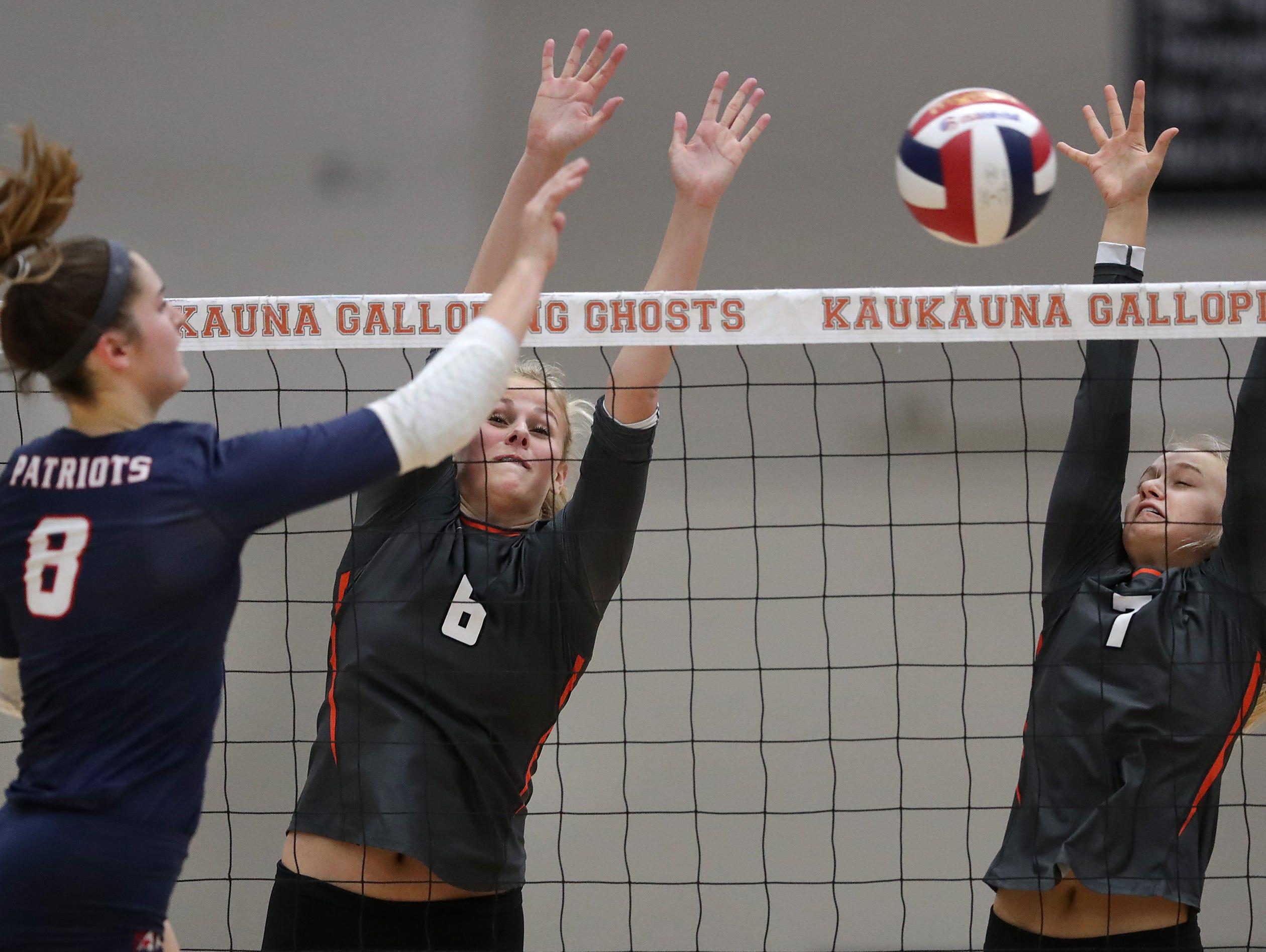 Appleton East High School's #8 Tiffany Paalman against Kaukauna High School's #6 Avery Torrey and #7 Savannah DeValk during their girls volleyball game on Thursday, October 11, 2018, in Kaukauna, Wis. Wm. Glasheen/USA TODAY NETWORK-Wisconsin.