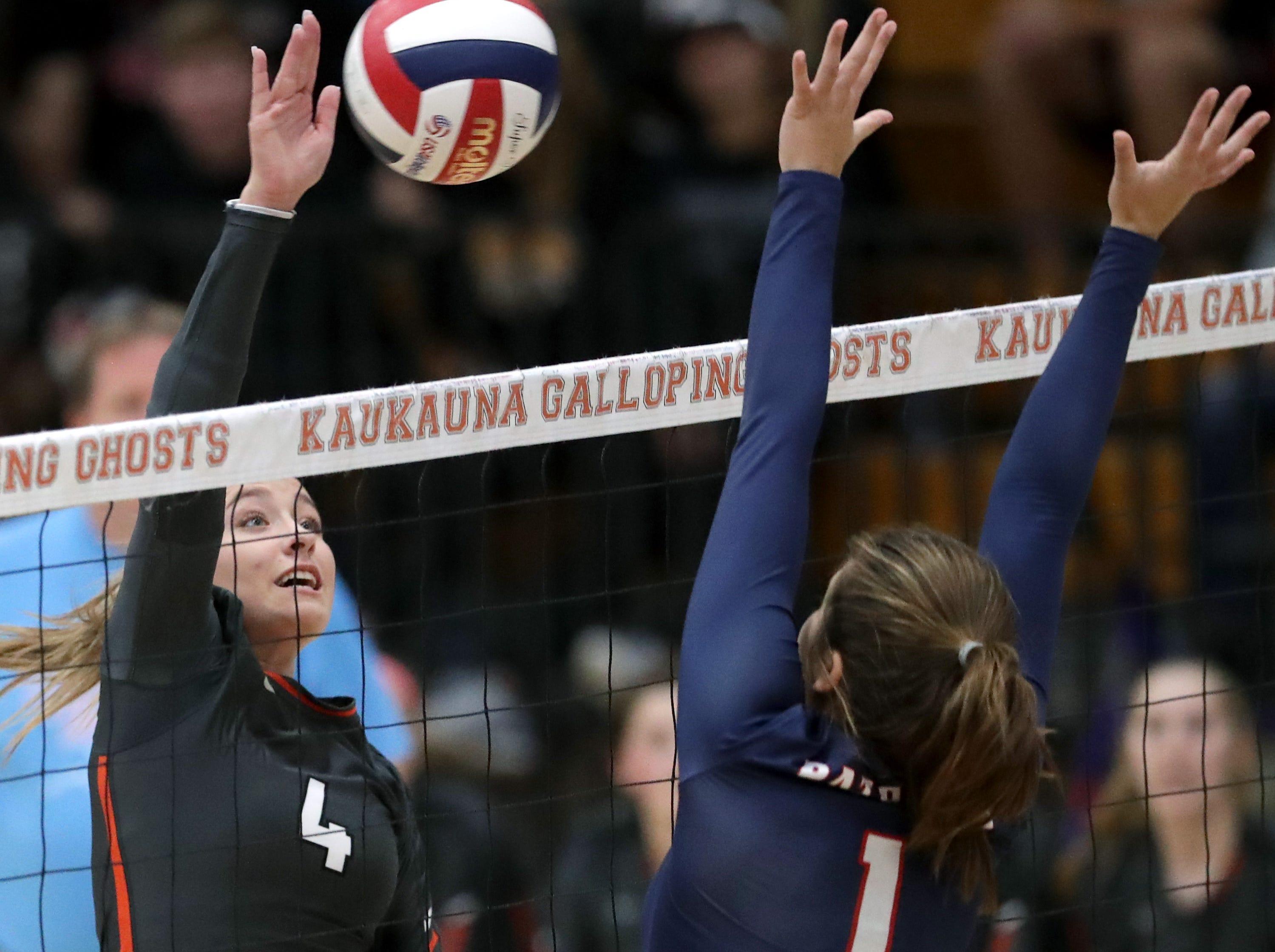 Kaukauna High School's #4 Taylor Ironside against Appleton East High School's #1 Olivia Meissner during their girls volleyball game on Thursday, October 11, 2018, in Kaukauna, Wis. Wm. Glasheen/USA TODAY NETWORK-Wisconsin.
