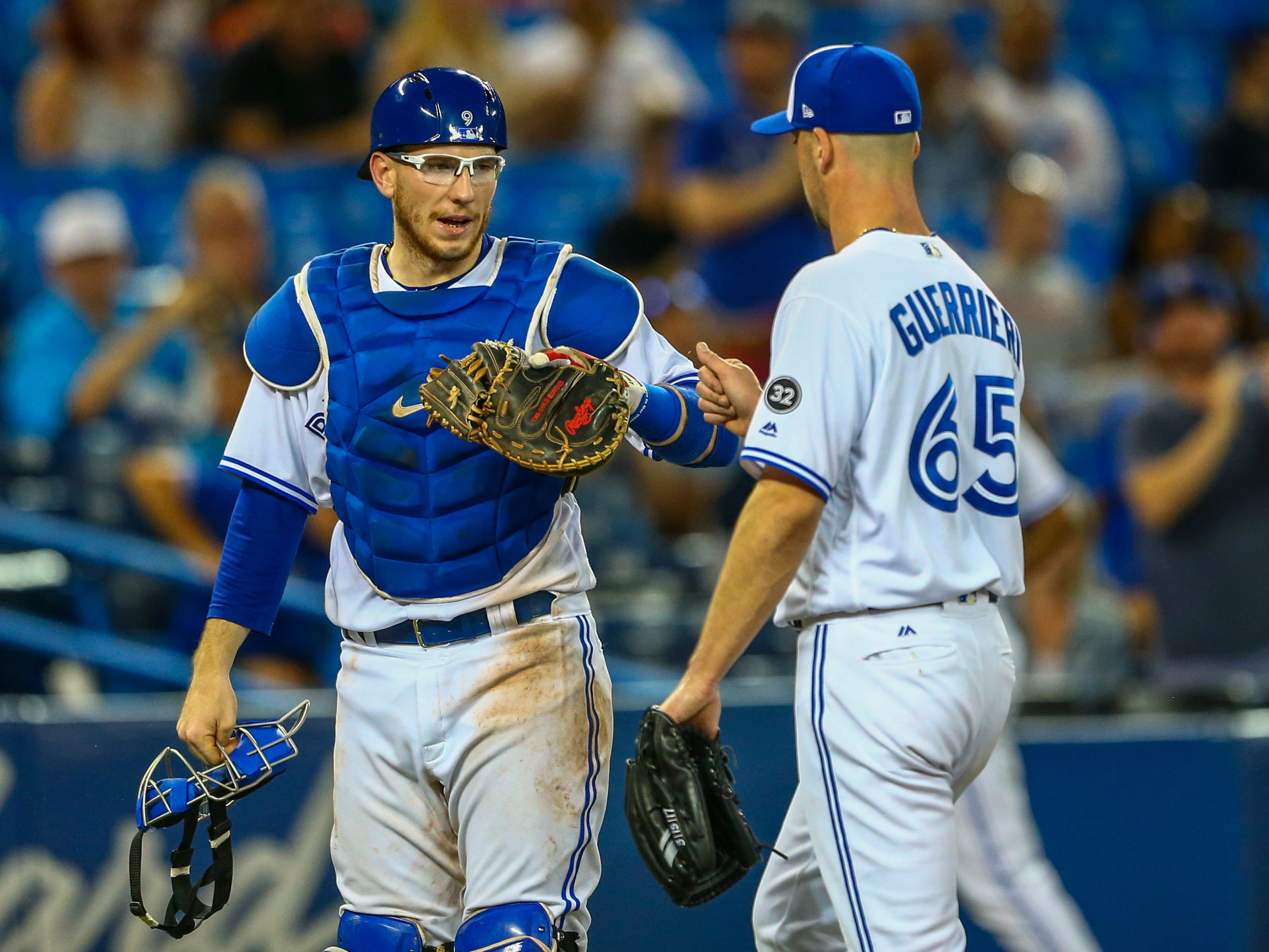 Sep 4, 2018; Toronto, Ontario, CAN; Toronto Blue Jays catcher Danny Jansen (9) gives starting pitcher Taylor Guerrieri (65) a high five after completing the eighth inning against the Tampa Bay Rays at Rogers Centre. Mandatory Credit: Kevin Sousa-USA TODAY Sports