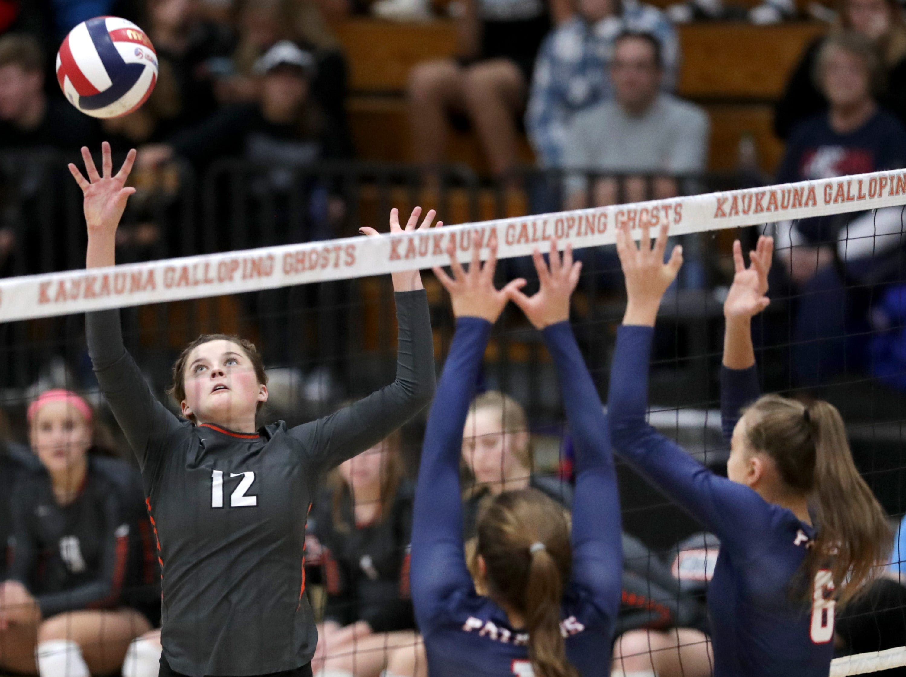 Kaukauna High School's #12 Emily VanDeHey against Appleton East High School's #1 Olivia Meissner and #6 Emily La Chapell during their girls volleyball game on Thursday, October 11, 2018, in Kaukauna, Wis. Wm. Glasheen/USA TODAY NETWORK-Wisconsin.